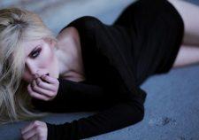 Black Sweater Girl Blonde Beauty Lies Down