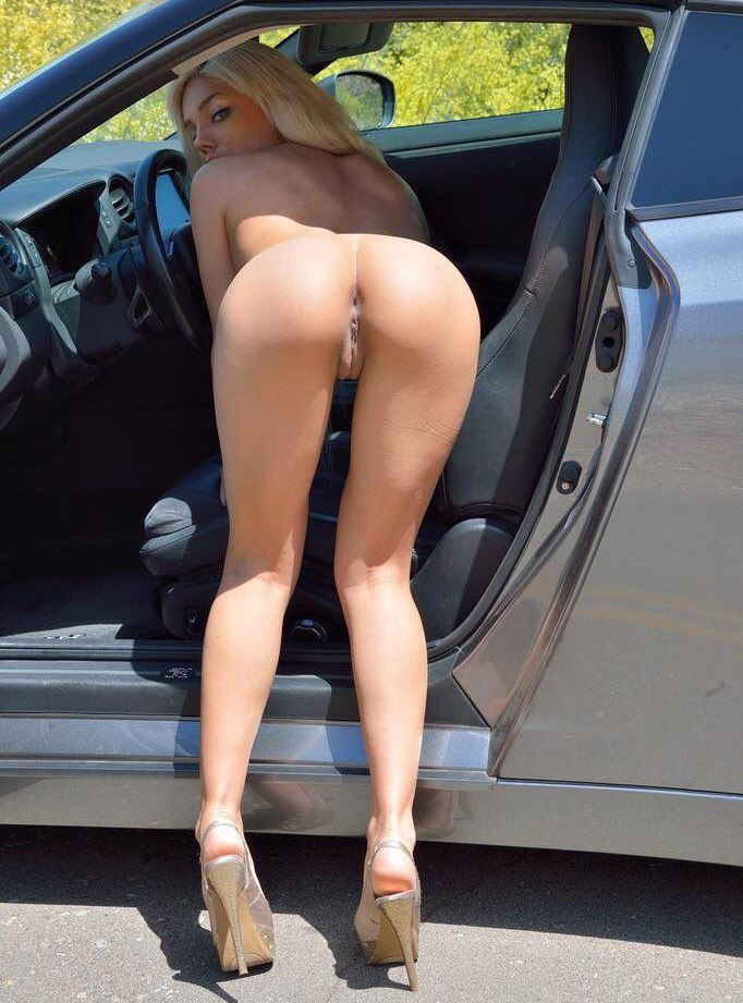 Nude blonde bent over ass in car