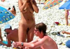 Nudist Couple Preparing For Tanning