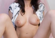 Amazing busty brunette with big boobs shows sweet pussy